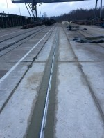 Canal construction in the road slabs, aluminum rail assembly