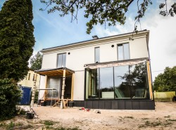 Timber frame house construction in Riga
